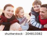 Portrait Of Family On Winter...