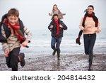 Family Running Along Winter...