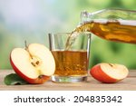 apple juice pouring from red... | Shutterstock . vector #204835342