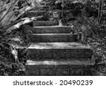 Stone steps in black and white produce an eerie scene - stock photo