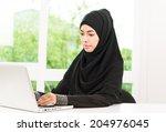 arab business woman working | Shutterstock . vector #204976045