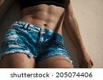 beautiful woman body in denim... | Shutterstock . vector #205074406