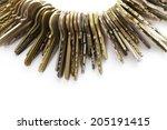 Many Old Brass Keys On White...
