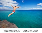 man jumping off cliff into the... | Shutterstock . vector #205221202