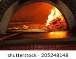pizza baking close up in the... | Shutterstock . vector #205248148