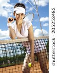 woman playing tennis in summer | Shutterstock . vector #205253482
