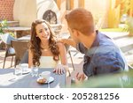 young couple talking on the... | Shutterstock . vector #205281256
