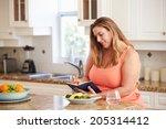 overweight woman on diet...   Shutterstock . vector #205314412
