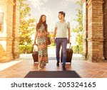 young couple standing at hotel... | Shutterstock . vector #205324165