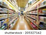 empty supermarket aisle  | Shutterstock . vector #205327162