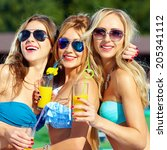 happy girls with beverages on... | Shutterstock . vector #205341112