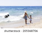 mother and daughter on the beach | Shutterstock . vector #205368706