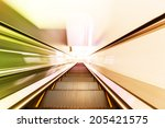 escalator fast run in metro... | Shutterstock . vector #205421575