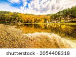 Small photo of River in the autumn forest. Autumn forest river landscape