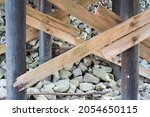 Worn Wooden Trusses And Stones...