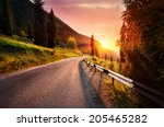 Road in the mountains at sunset in Kazakhstan - stock photo