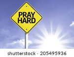 pray hard road sign with sun... | Shutterstock . vector #205495936