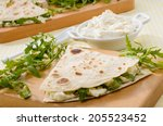 piadina with arugula and cheese | Shutterstock . vector #205523452