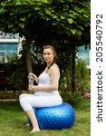 beautiful pregnant woman... | Shutterstock . vector #205540792