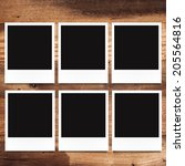 blank photo frames on wood... | Shutterstock . vector #205564816