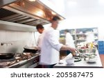 motion chefs of a restaurant... | Shutterstock . vector #205587475