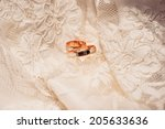 gold wedding rings lie on the... | Shutterstock . vector #205633636