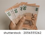 woman hand with euro money on... | Shutterstock . vector #2056555262