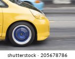 Car moving in street at rush hour - stock photo