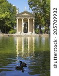 Small photo of Rome, Italy - July 02: picturesque landscape with pond and Temple of Aesculapius at Villa Borghese gardens, on July 02, 2014, Rome, Italy