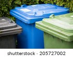 Garbage Cans In Different...