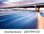 car driving on freeway at... | Shutterstock . vector #205799725