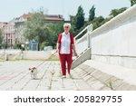 Stock photo senior woman walking her dog 205829755