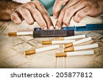male hands making cigars with... | Shutterstock . vector #205877812