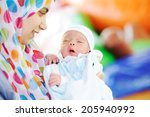 muslim mom with newborn baby... | Shutterstock . vector #205940992