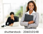 Black Business Woman Holding...