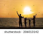 Silhouette Of Happy Family On...