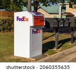 Small photo of Brandon, MS - October 6, 2021: FedEx Drop Box near other mail boxes