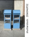 Blue Newspaper Dispensers On...