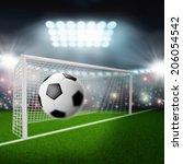 soccer ball flies into the goal   Shutterstock . vector #206054542