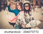 Multi Ethnic Girls On A Scooter ...