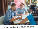 young man consulting his... | Shutterstock . vector #206135278
