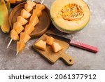 Ripe Melon On Skewers And A...