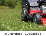 mower  lawn mower on the grass... | Shutterstock . vector #206225836