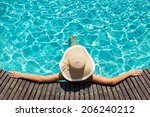 woman with big hat relaxing on... | Shutterstock . vector #206240212