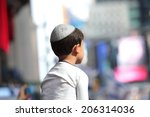 Small photo of NEW YORK CITY - JULY 20 2014: several thousand supporters of Israeli actions in Gaza staged a rally in Times Square. Yarmulka wearing boy with Times Square background