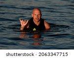 Portrait Of Wet Bald Man In...