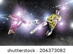 two young football players... | Shutterstock . vector #206373082