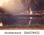 girl sitting on a bench | Shutterstock . vector #206378422
