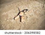 Young Woman Sunbathing In...