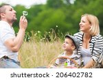 happy family outdoors | Shutterstock . vector #206402782